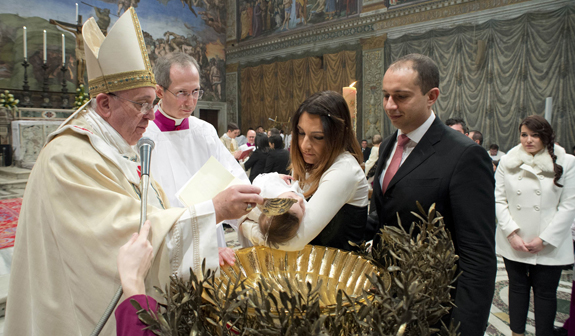 Pope Francis baptizes infant in Sistine Chapel at Vatican